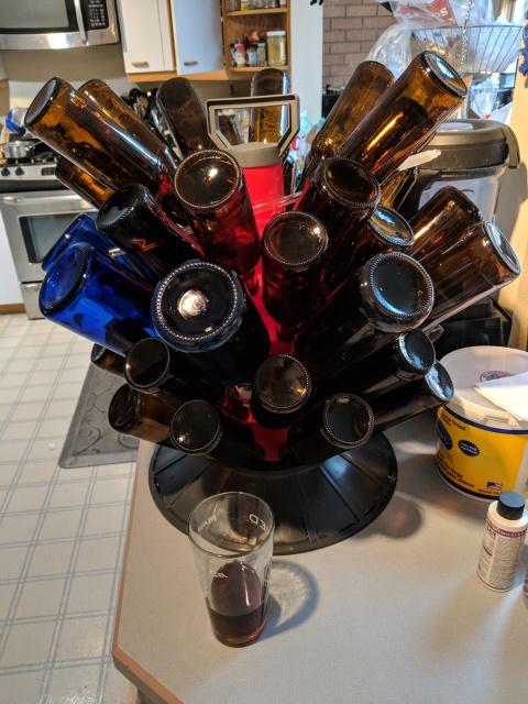 [Drying tree full of bottles]