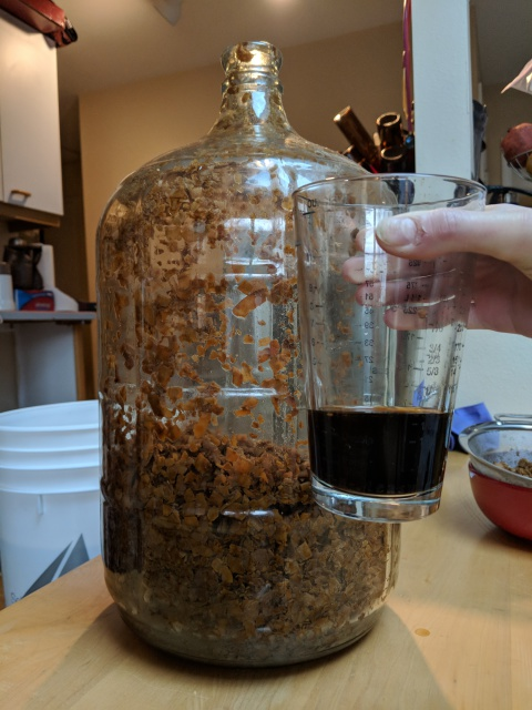 [Dark beer and a messy carboy full of coconut flakes]